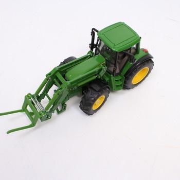 Traktor s přívěsem na kulaté balíky Siku 386