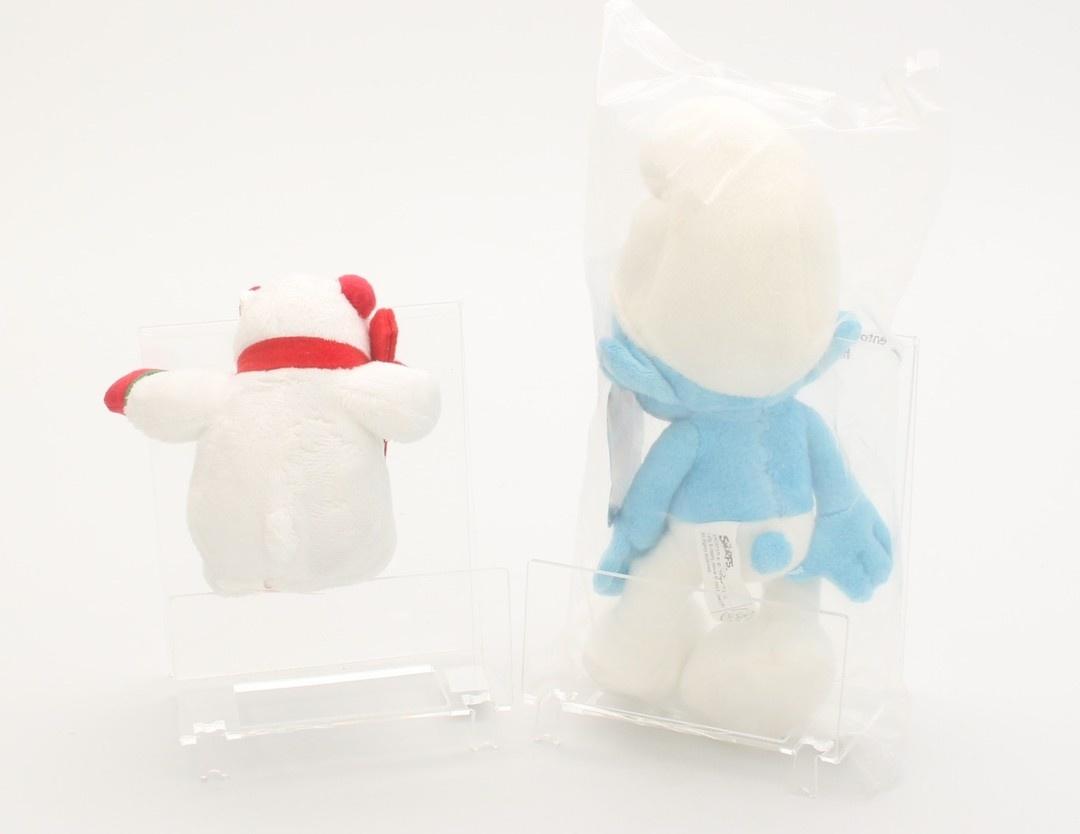 Plyšové hračky šmoula a lední medvídek