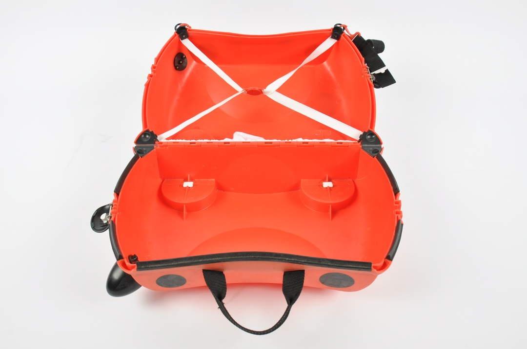 Cestovní červený dětský kufr na kolečkách Trunki
